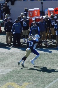 Navy DB Tyris Wooten breaks up a pass during the first half.