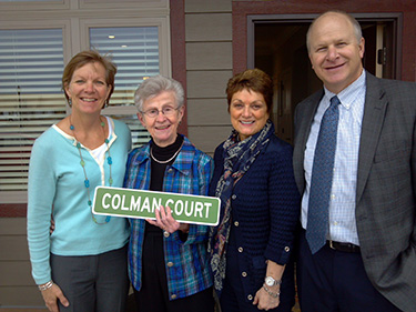 "Photo below for the ""Working for You"" section Alt Text: This photo of Colleen, S. Colman, Molly and Brad celebrate the naming of Colman Court"
