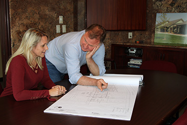 John and Christa meet over plans at Collegeville Brokerage.
