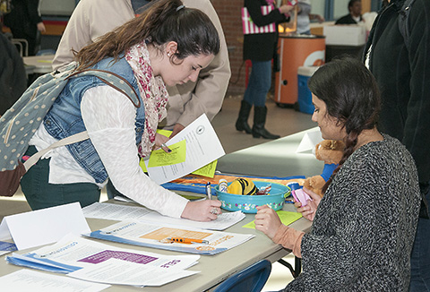 A Collin College Student visits a booth at the Dance for Dignity event, Feb. 19.