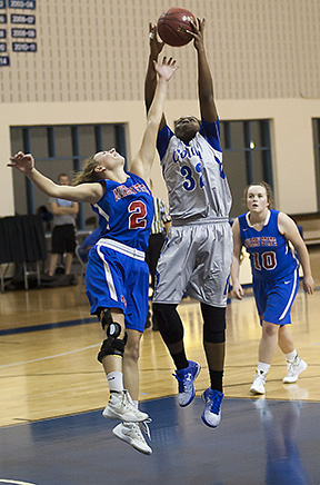 Zhanae Whitney pulls down a rebound in the Lady Cougars' game against Murray State.