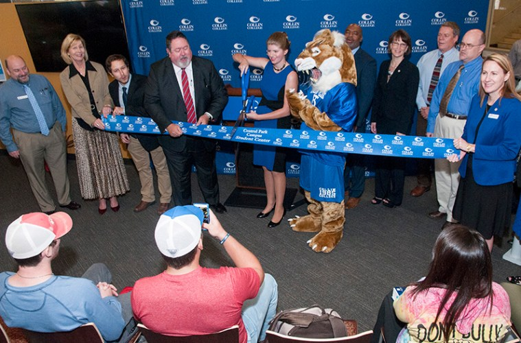 Collin officials and student government representatives cut the ribbon at the new Central Park Campus student center.