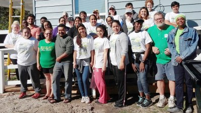 Members of various Collin College student organizations gather for a picture after a hard day of work at the Habitat For Humanity job site.