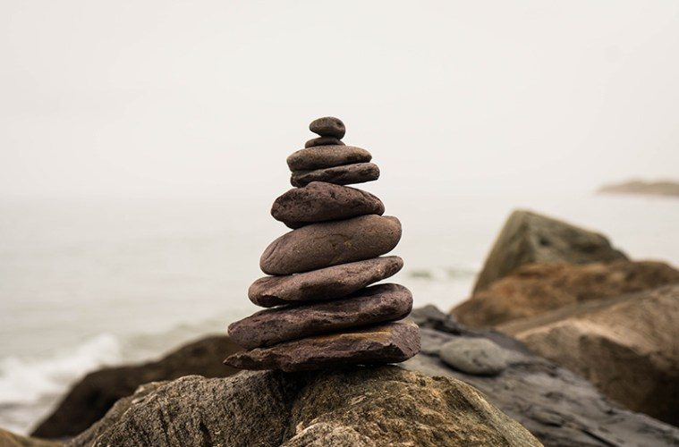 image of stacked rocks by ocean