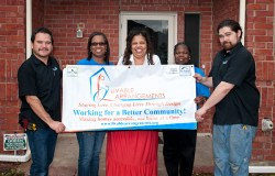 Installers from Shower Doors of Dallas (on ends) stand with (from left) Livable Arrangements founder Lenora Kelson, client Charlotte Dixon and LA Board Member Delphia Fegans.