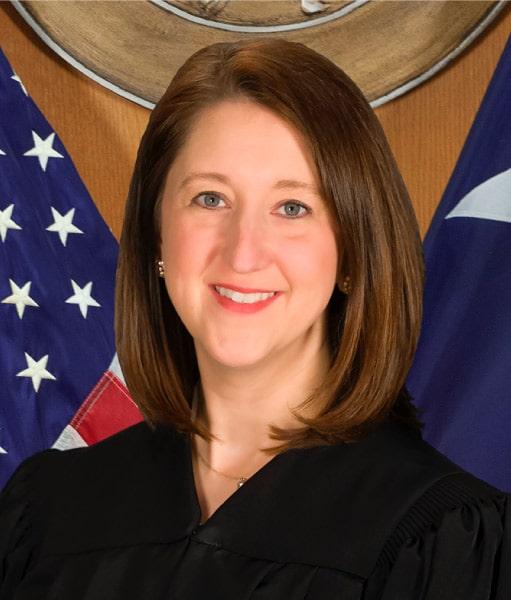 Judge Andrea Bouressa