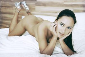 woman naked on bed