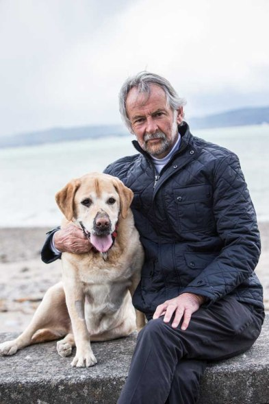 Colm Keane with Frankie, the Labrador who has adopted him