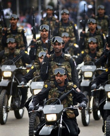 Special Forces Combat soldiers ride in a parade during a war victory ceremony in Colombo