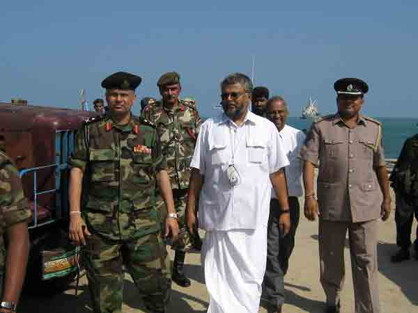 Jaffna Government Agent K. Ganesh with Minister Douglas Devananda and Security Forces Commander, Jaffna Major General G.A. Chandrasiri ( the present governor in North ) at the Point Pedro port yesterday .