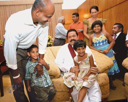 Defence Minister Rajapaksa with Sinhala children