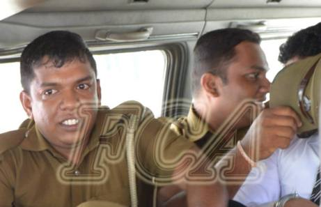 Officers had shielded the Vidanapathirana while escorting him back to the Prison from the Colombo magistrate courts after the verdict was given   Photo Foreign Correspondents' Association of Sri Lanka - Facebook page