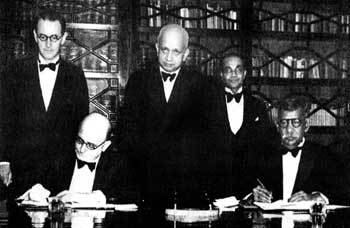 Signing of the Declaration of Independence Agreement in 1948: Seated- Sir Henry Monck-Mason Moore, Governor of Ceylon, D.S. Senanayake, Prime Minister. Standing-C.H. Mulhall, Sir Oliver Goonetilleke, Sir Arthur Ranasinghe