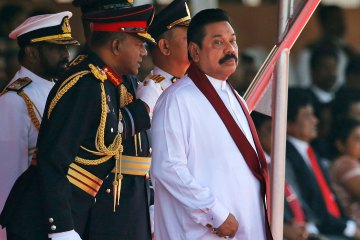 President Mahinda Rajapaksa listens to Army Commander Lt. Gen. Daya Ratnayake  ( Photo Courtesy AP /Eranga Jayawardena)