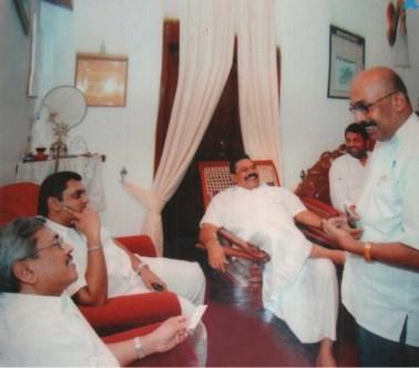 Rajapaksas' astrologer Sumanadasa Abeygunawardena with Rajapaksas