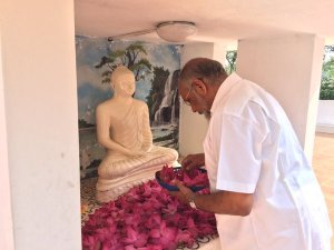 C. V. Wigneswaran Worships at Naga Vihara, the Buddhist Shrine | File photo