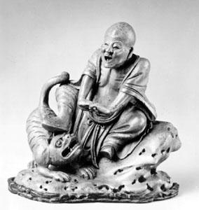 Bamboo sculpture of a tiger-taming lohan