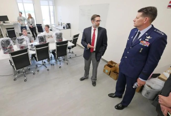 General Thompson speaks with Professor Marcus Holzinger in his laboratory on campus