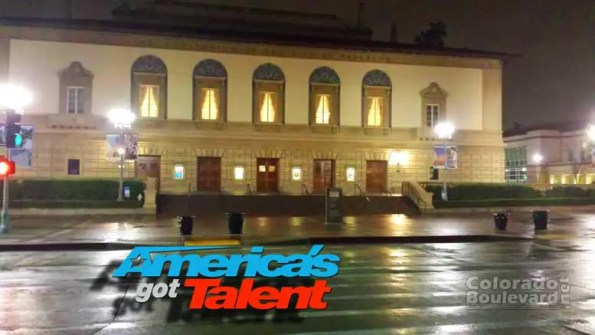 A building lit at night with logo of AGT on the top