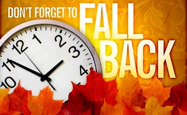 """Fall levaes, a clock and the words """"Fall Back"""""""