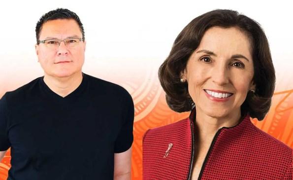 Male wearing black t-shirt on the right and a woman wearing a red blazer on the left with an abstract orange colored background