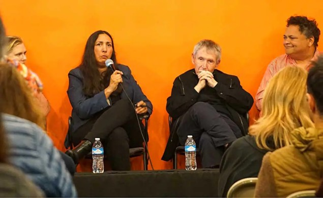 4 panel members discussing the impact of jonathan gold in front of an orange colored wall