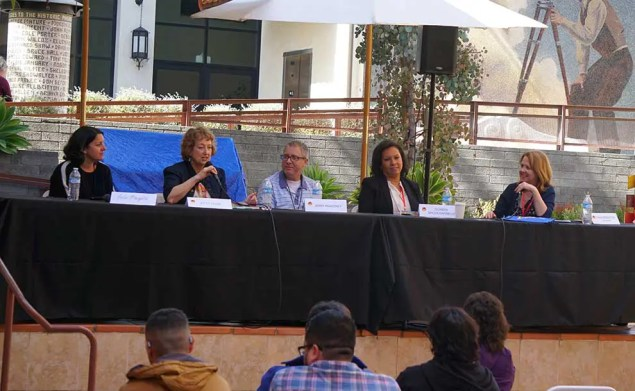 A panel of 4 people at Vroman's courtyard with two murals behind them