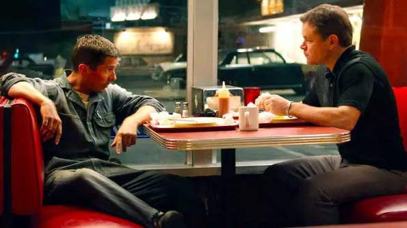 2 guys talking to each other at a diner
