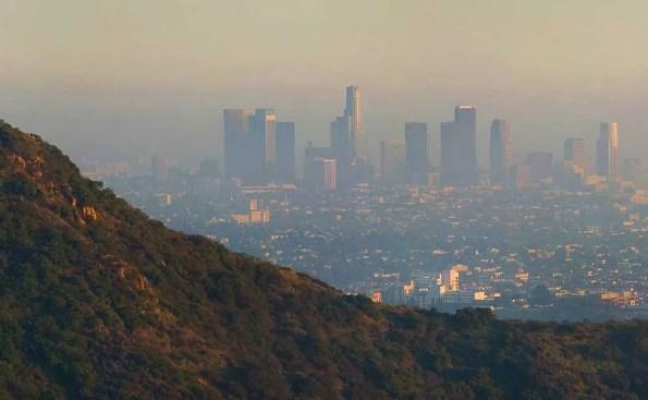 A metropolitan city with haze and smog around it