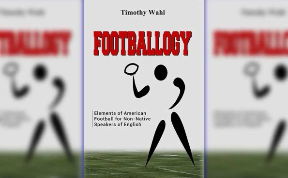 a book cover of aplayer throwing football