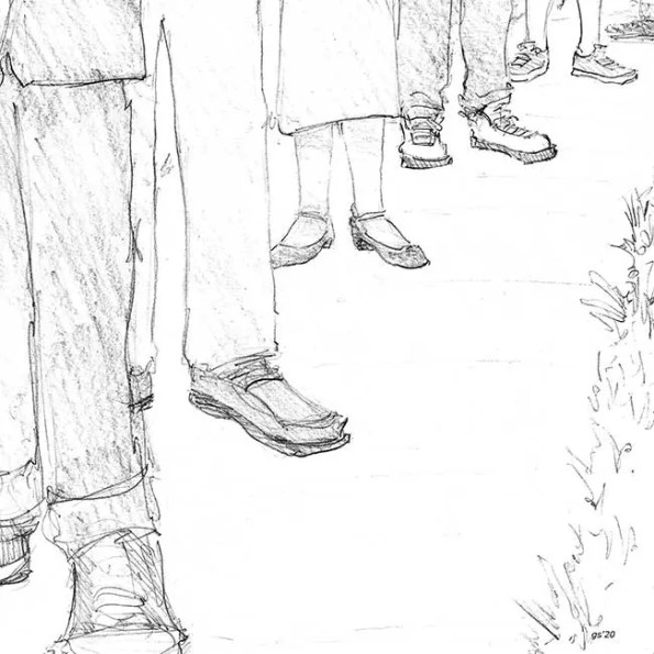 people feet standing in line to vote
