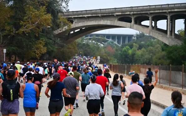 runners under a bridge
