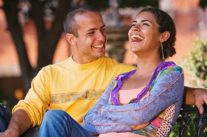 Happily married couple laughing. Marriage counseling and EFT for couples.