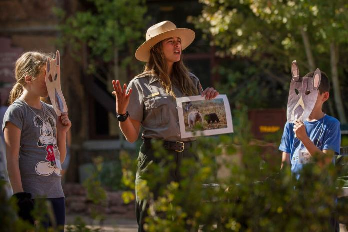 Kelsey Persyn, a Rocky Mountain National Park ranger, teaches a bear education program. Persyn utilizes props and the help of eager young volunteers to teach visitors the difference between black and grizzly bears. (Photo by Andria Hautamaki)