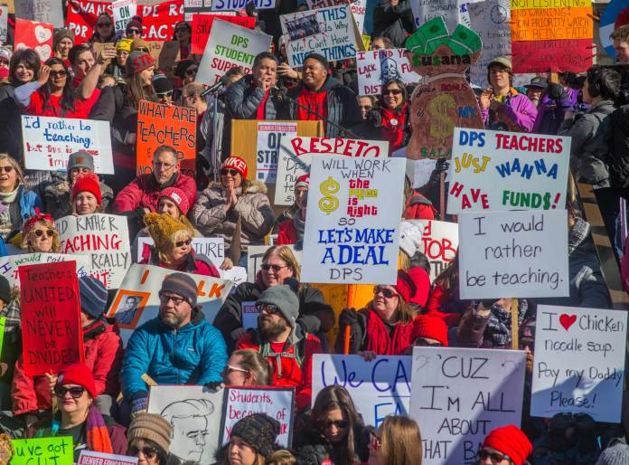 Striking teachers and supporters rallied on the west steps of the Colorado State Capitol Feb. 11, 2019. (Photo by Evan Semón Photography for The Colorado Independent)