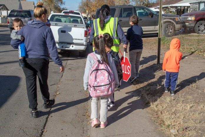Students walking home from Swansea Elementary in October 2018. The school is among 10 Denver Public Schools that are part of a city of Denver program that will deploy highly localized air quality sensors in an effort to protect student health and reduce asthma rates. (Photo by Phil Cherner for The Colorado Independent)