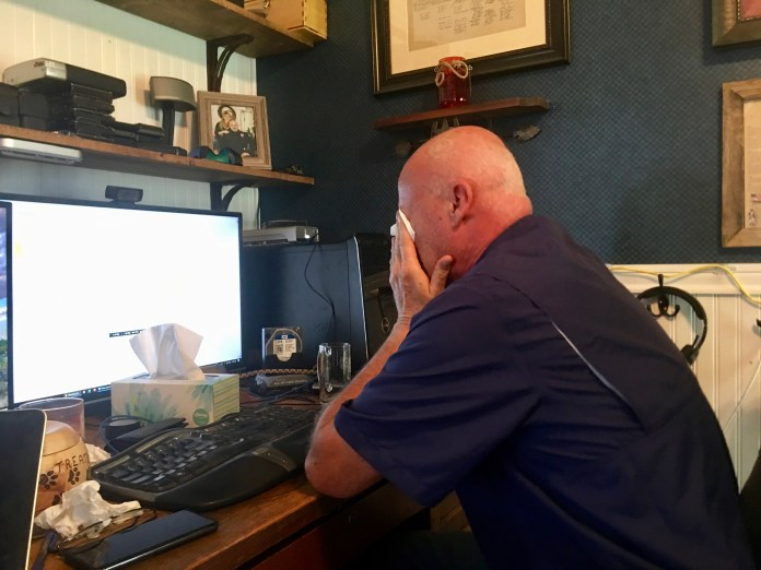 Former Police Lt. Roy Kinney cries in his home office as he talks about what he would say to Daniel Pierce's wife and mother. (Photo by Susan Greene)
