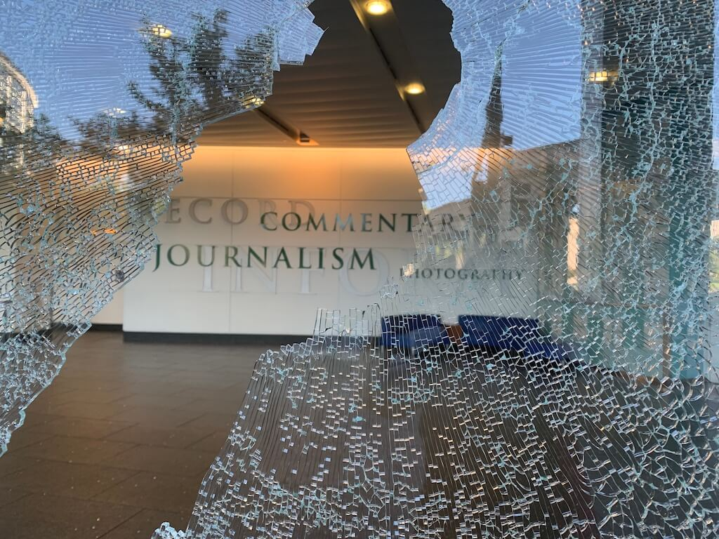 Looking through a broken window to the lobby of the old Denver Post building the morning after the May 29, 2020 racial justice protest in downtown Denver.