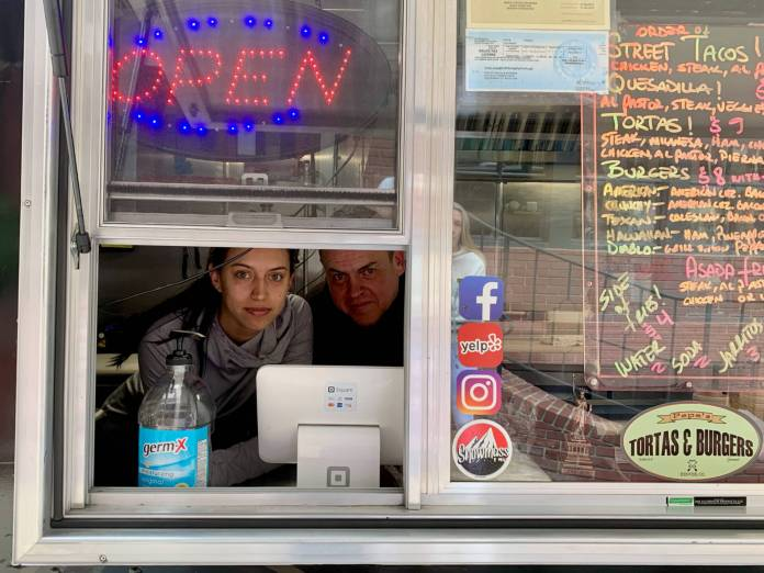 Food truck owner Pepe Garayoa and his daughter Catalina wait for business Wednesday across from Denver's Union Station. (Photo by Susan Greene)