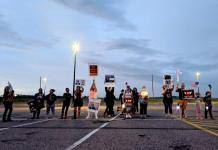Family members of inmates at the Sterling Correctional Facility hold a candlelight vigil just outside the prison walls June 6, 2020. (Photo by Sam Brasch/CPR News)