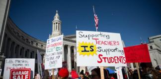 Denver teachers rally on the first day of a three-day strike.