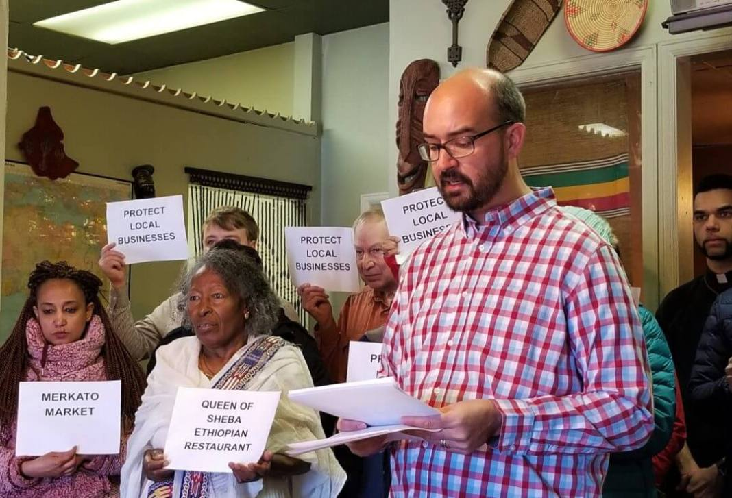 Brendan Greene, a member of the East Colfax Community Collective, speaks about the group's recommendations for development in the East Colfax area at the Queen of Sheba restaurant on Feb. 5, 2020. (Photo by Forest Wilson)