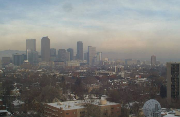 Photo of smoggy downtown Denver skyline via the Colorado Department of Public Health and Environment, Air Pollution Control Division, Technical Services Program, Wednesday, March 6, 2019.