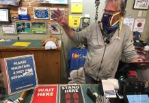 Mountain Fever co-owner Bruce Gulde discusses the expectations for shoppers at his store in Ouray, which sells everything from T-shirts to other souvenirs. Gulde and his wife, Tamara, decided to reopen the shop with rules, including one requiring shoppers to wear masks and distance themselves in the store.