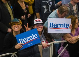 Two Bernie Sanders' supporters gather among thousands at a rally Sunday, Feb. 16, 2020, at the Colorado Convention Center. (Photo by Evan Semón)