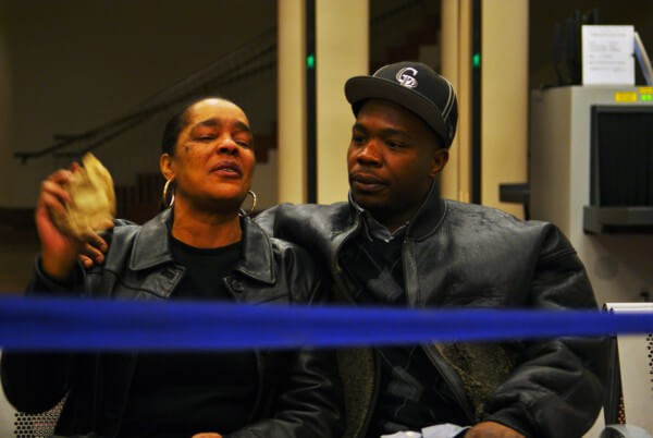 Clarence Moses-EL's wife Stephanie Burke and son Anthony Burke wait for Moses-EL's release from the Denver jail.