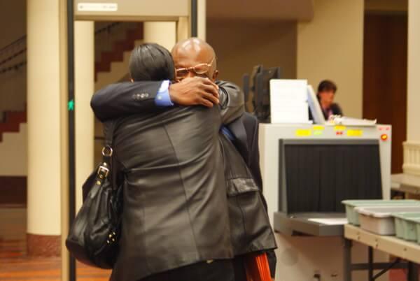 Moses-EL embraces his wife, Burke. Photo: Robert McGoey