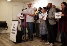 Members of the East Colfax Community Collective announce its formation to combat business and community displacement on Nov. 21, 2019. The Collective launched relief fund for small businesses on East Colfax impacted by COVID-19 on April 30, 2020. (Photo by Forest Wilson)