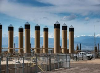 A Crestone Peak oil and gas operation on County Line Road in Weld County. The site contains 16 wells, 40 oil tanks, 26 combustors, 17 separators.