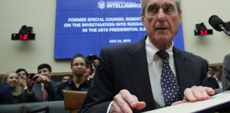 WASHINGTON, DC - JULY 24: Former Special Counsel Robert Mueller waits to testify before the House Intelligence Committee about his report on Russian interference in the 2016 presidential election in the Rayburn House Office Building July 24, 2019 in Washington, DC. Mueller testified earlier in the day before the House Judiciary Committee in back-to-back hearings on Capitol Hill. (Photo by Alex Wong/Getty Images)